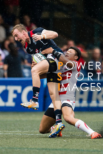 Ryuji Noguchi of Japan (R) puts a tackle on Alex McQueen of Hong Kong (L) during the Asia Rugby Championship 2017 match between Hong Kong and Japan on May 13, 2017 in Hong Kong, China. Photo by Marcio Rodrigo Machado / Power Sport Images