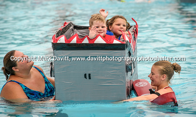 Indianola Park and Recreations hosted cardboard boat races at the Veteran's Memorial Aquatic Center July 22. Thiessen and Warner Allen-Cosimo took a ride in the race on the The Shark with the help of Amber Allen-Cosimo and life guard Madi Green, left.