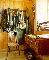 A rank of wicker baskets is a practical storage solution in this country cloakroom