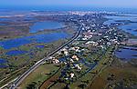Townscape nestled along the Rhone river delta, Saintes-Maries-de-la-Mer, Camargue, France.