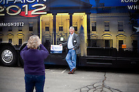 A man poses for pictures in front of the C-SPAN bus outside a Mitt Romney town hall meeting and rally at the Rochester Opera House in Rochester, New Hampshire, on Jan. 8, 2012. Romney is seeking the 2012 Republican presidential nomination.