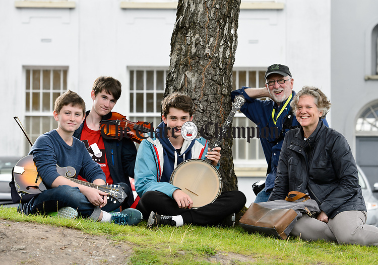 The Coleman's of St Paul, Minnesota ; Finn, Mac, Declan, dad Nick and mum Laura take a break from Eigse class at Colaiste Muire during Fleadh Cheoil na hEireann in Ennis. Photograph by John Kelly.
