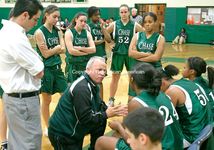 WATERBURY, CT-- 10 DECEMBER 2007--121007JS10-Chase Collegiate girls basketaball coach Raymond Behr, talks with his platers during a time out in their 46-30 win over Watkinson Monday at Chase Collegiate School in Waterbury. To view a slideshow from this game go to www.rep-am.com.<br /> Jim Shannon/Republican-American