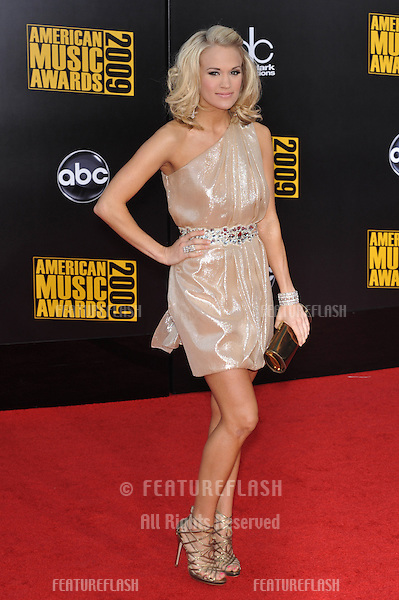 Carrie Underwood at the 2009 American Music Awards at the Nokia Theatre L.A. Live..November 22, 2009  Los Angeles, CA.Picture: Paul Smith / Featureflash