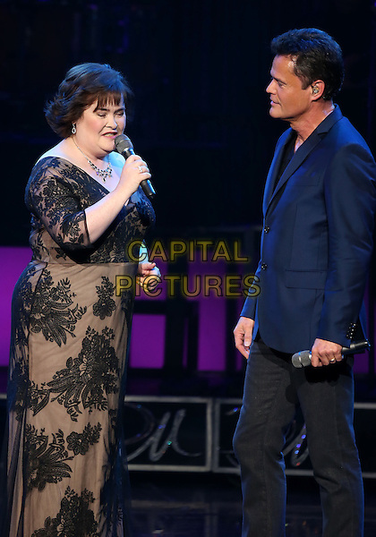 Susan Boyle & Donny Osmond.Susan Boyle Performs With Donny Osmond at Donny & Marie Show at Flamingo Las Vegas,  Las Vegas, Nevada, USA..October 17th, 2012.on stage in concert live gig performance performing music full length blue suit jacket singing black trousers grey gray lace dress side profile half 3/4    .CAP/ADM/MJT.© MJT/AdMedia/Capital Pictures.