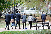 With Secret Service agents in tow, United States President Barack Obama walks through Lafayette Park to St. John's Episcopal Church with his daughters on Sunday, October 28, 2012. From left to right:  Kaye Wilson, Godmother to Malia and Sasha, Sasha Obama, President Obama, Malia Obama. .Credit: Dennis Brack / Pool via CNP