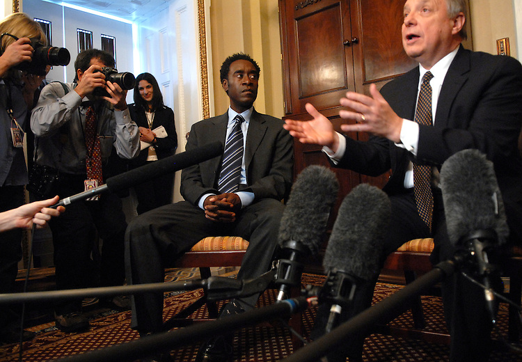 Actor Don Cheadle attends, center, a news conference on the genocide in Darfur.  Cheadle was on the Hill to testify at a hearing on the situation.  Sen. Dick Durbin, D-Ill., appears at right.