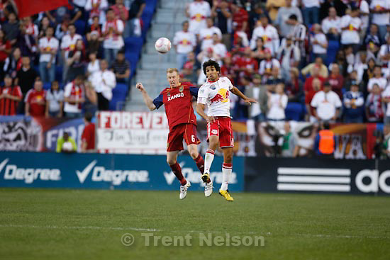 Trent Nelson  |  The Salt Lake Tribune.Real's Nat Borchers heads the ball, with New York's Mehdi Ballouchy at right, during the second half, New York Red Bulls vs. Real Salt Lake, MLS Soccer Saturday, October 9, 2010 at Red Bull Arena in Harrison, New Jersey.