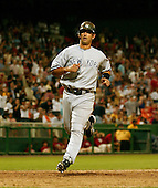 Washington, D.C. - June 16, 2006 -- New York Yankees catcher Jorge Posada (20) scores the insurance run in the ninth inning against the Washington Nationals at RFK Stadium in Washington, D.C. on June 16, 2006.  The Yankees won the game 7 - 5.<br /> Credit: Ron Sachs / CNP