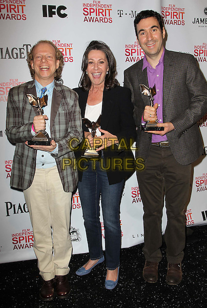 Bruce Cohen, Donna Gigliotti, Jonathan Gordon.2013 Film Independent Spirit Awards - Press Room  Held At Santa Monica Beach, Santa Monica, California, USA, 23rd February 2013..indy indys indie indies full length jeans brown suit purple shirt black jacket tartan plaid .CAP/ADM/FS.©Faye Sadou/AdMedia/Capital Pictures.