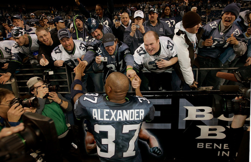 SEATTLE-Indianapolis Colts vs. Seattle Seahawks--Seahawks #37 Shaun Alexander is swarmed by fans and media after beating the Indianapolis Colts at Qwest Field in Seattle on Saturday December 24, 2005.(Kevin P. Casey/Wireimage.com)
