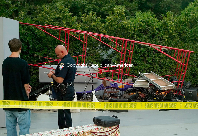 CHESHIRE, CT- 17 JULY 2008 --071708JS04-Cheshire police talks with stage hand Conor Elmer, left, as they investigate the cause of a scaffolding collapse on Thursday that injured four people during the Cheshire Performing and Fine Arts production of Once Upon a Mattress at Cheshire Park. <br /> Jim Shannon / Republican-American