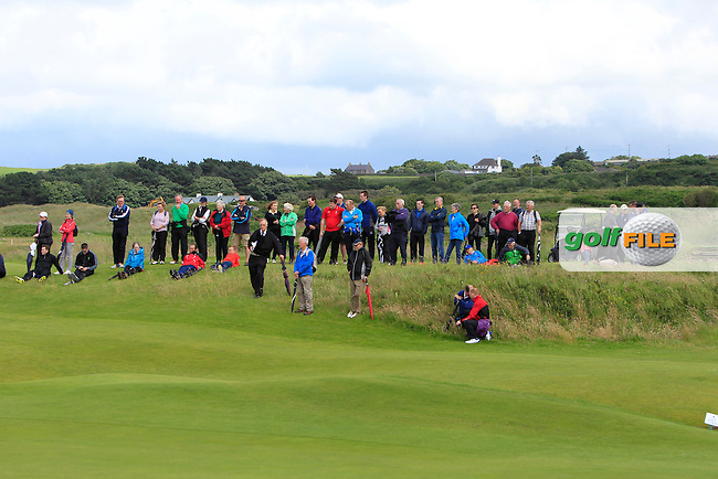 Watching on the 11th during the Final (Matchplay) in the North of Ireland Amateur Open Championship sponsored by Cathedral Eye Clinic at Portrush Golf Club, Portrush on Friday 15th July 2016.<br /> Picture:  Thos Caffrey / www.golffile.ie