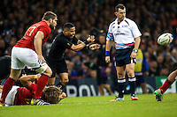 Aaron Smith passes during the Rugby World Cup 2015 rugby union match between the New Zealand All Blacks and France at The Millennium Stadium, Wales on 17 October 2015. No unauthorized download. Photo: Dean Woodgate / rainywoodphotography.co.uk