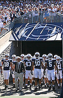 STATE COLLEGE, PA - SEPTEMBER 19: Head coach Joe Paterno of the Penn State Nittany Lions leads his team onto the field before a game against the Temple Owls on September 19, 2009 at Beaver Stadium in State College, Pennsylvania. (Photo by Hunter Martin/Getty Images) *** Local Caption *** Joe Paterno