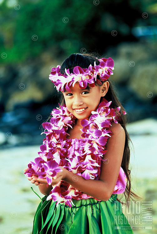Lovely Hawaiian hula girl( age 7) with orchid leis and ti leaf skirt