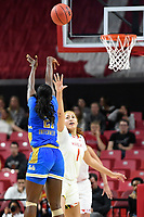 College Park, MD - March 25, 2019: UCLA Bruins forward Michaela Onyenwere (21) hits a three pointer over Maryland Terrapins forward Shakira Austin (1) during second round game of NCAAW Tournament between UCLA and Maryland at Xfinity Center in College Park, MD. UCLA advanced to the Sweet 16 defeating Maryland 85-80.(Photo by Phil Peters/Media Images International)
