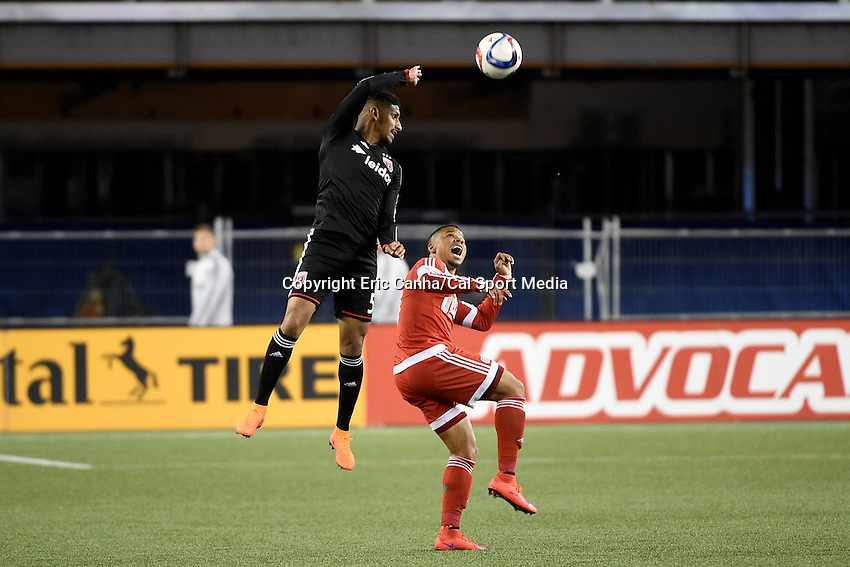 May 23, 2015 - Foxborough, Massachusetts, U.S. - New England Revolution forward Charlie Davies (9) and D.C. United defender Sean Franklin (5) in game action during the MLS game between DC United and the New England Revolution held at Gillette Stadium in Foxborough Massachusetts. The New England Revolution and D.C. United ended the game tied 1-1.  Eric Canha/CSM