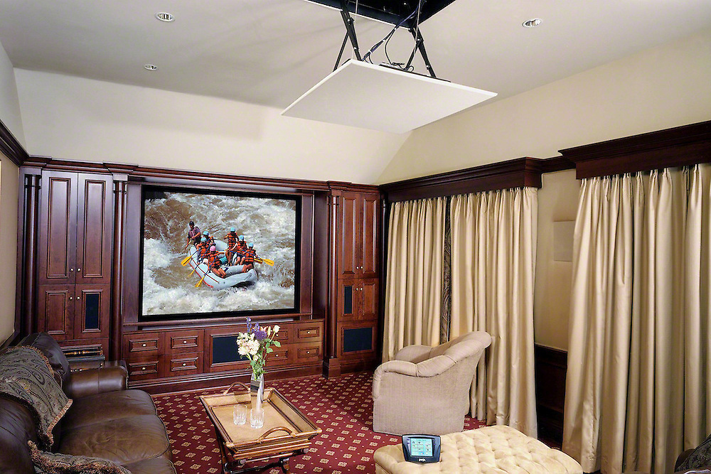 Custom Cabinet With Large Screen And Motorized Ceiling Lift