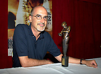 Montreal, June 28th 2001<br /> <br /> American Jazz musician Michael Brecker pose for photographers with  the 8th Miles-Davis Awardthat he received  from the Montreal Jazz Festibal, June 28th 2001.<br /> <br /> This award highlight the entire work of a Jazz artist  and his contribution to the renewal of the form.<br /> Breckeralready  won 2 grammys awards in 1997 and has played with many musicians including Paul Simon, Herbie Hancock, Pat Metheny and Bruce Springsteen as well as his brother Randy with whom he founded the Brecker Brother in the70's<br /> <br /> <br /> <br /> <br /> <br /> PHOTO :  Agence Quebec Presse
