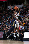 Brandon Childress (0) of the Wake Forest Demon Deacons shoots over TJ Gibbs (10) of the Notre Dame Fighting Irish during second half action at the LJVM Coliseum on February 24, 2018 in Winston-Salem, North Carolina. The Fighting Irish defeated the Demon Deacons 76-71.  (Brian Westerholt/Sports On Film)