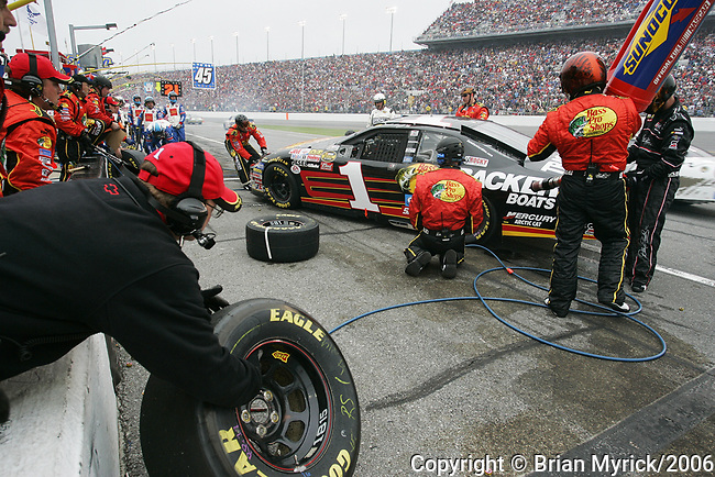 Crew members tend to the No. 1 Bass Pro Shops Chevrolet, driven by Martin Truex Jr. along pit road during the running of the Daytona 500 auto race at Daytona International Speedway in Daytona Beach, Fla., Sunday, Feb. 19, 2006.(AP Photo/Brian Myrick)
