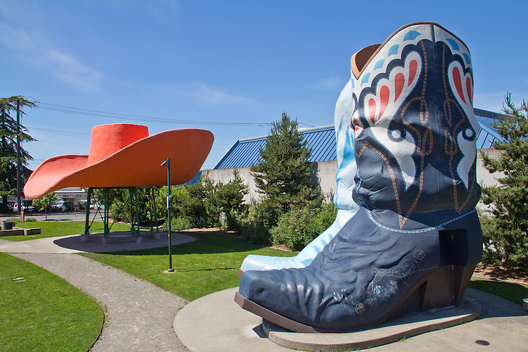 Seattle, Hat and Boots, One time Premium Tex gas station, outsized cowboy hat and boots buildings saved and restored by Georgetown community, Oxbow Park, Seattle Parks, Washington State, United States,