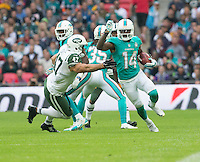 04.10.2015. Wembley Stadium, London, England. NFL International Series. Miami Dolphins versus New York Jets. Miami Dolphins Wide Receiver Jarvis Landry running with the ball along the side line past New York Jets Tight End Kellen Davies.