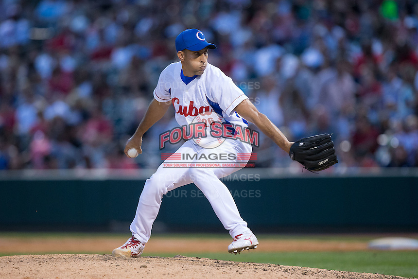 Cuban National Team relief pitcher Yander Guevara Morales (26) in action against the US Collegiate National Team at BB&T BallPark on July 4, 2015 in Charlotte, North Carolina.  The United State Collegiate National Team defeated the Cuban National Team 11-1.  (Brian Westerholt/Four Seam Images)