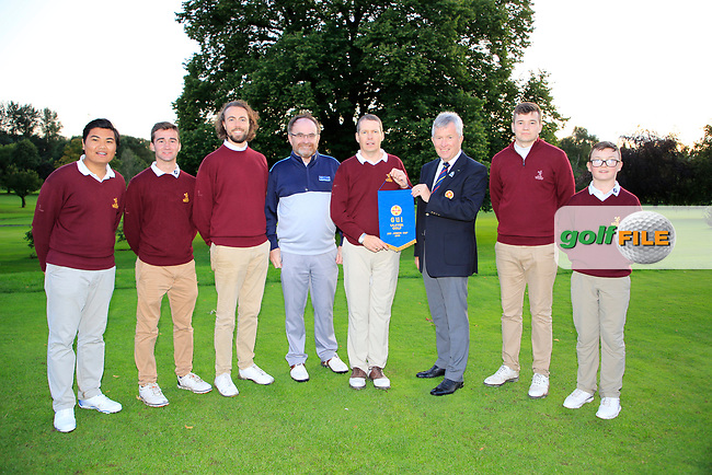 Dermot Rollins of Rollins Insurance Brokers (AIG) and John White Ulster Golf present the pennant to Malone Team Captain  after the AIG Junipr Cup Ulster Fianl in Lisburn Golf Club, Lisburn, Down, Northern Ireland. 31/08/2019.<br />