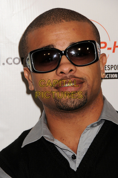RAZ B of B2K (De'Mario Monte Thornton).Russell Simmons and US Magazine host 2009 Grammy Awards Post Party at a Private Residence, Beverly Hills, California, USA..February 8th, 2009.headshot portrait sunglasses shades goatee facial hair .CAP/ADM/BP.©Byron Purvis/AdMedia/Capital Pictures.