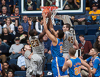Jabari Bird of California fights for a loose ball against Kyle Anderson of UCLA during the game at Haas Pavilion in Berkeley, California on February 19th, 2014.  UCLA defeated California, 86-66.