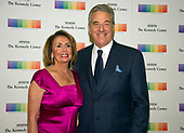United States House Minority Leader Nancy Pelosi (Democrat of California) and her husband, Paul, arrive for the formal Artist's Dinner honoring the recipients of the 40th Annual Kennedy Center Honors hosted by United States Secretary of State Rex Tillerson at the US Department of State in Washington, D.C. on Saturday, December 2, 2017. The 2017 honorees are: American dancer and choreographer Carmen de Lavallade; Cuban American singer-songwriter and actress Gloria Estefan; American hip hop artist and entertainment icon LL COOL J; American television writer and producer Norman Lear; and American musician and record producer Lionel Richie.  <br /> Credit: Ron Sachs / Pool via CNP
