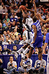 Connecticut forward Jeff Adrien (4) shoots over Kentucky forward Sheray Thomas (23).  Connecticut defeated Kentucky 87-83 in the second round of the NCAA Tournament  at the Wachovia Center in Philadelphia, Pennsylvania on March 19, 2006.