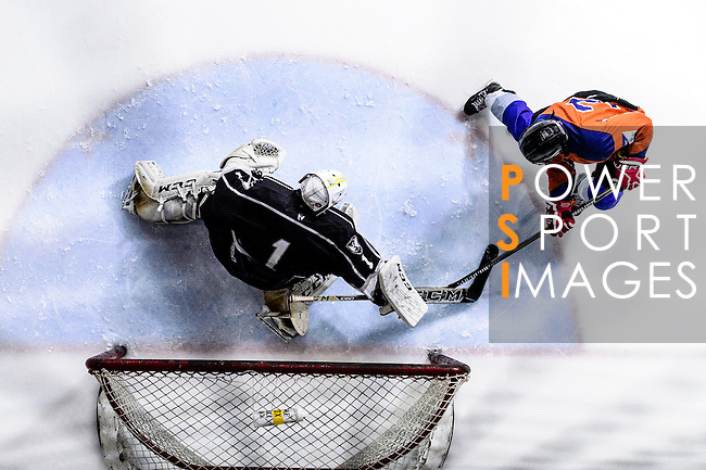 Principal Team Defense #7 Ryan Lee (r) battle in the goal mouth against Gaggia Empire Goalie #1 Anthony Devolz (l) during the Principal Standard League match between Principal vs Gaggia Empire at the Mega Ice on 24 January 2017 in Hong Kong, China. Photo by Marcio Rodrigo Machado / Power Sport Images