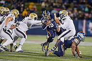 Annapolis, MD - December 28, 2015:    Navy Midshipmen quarterback Keenan Reynolds (19) avoids the tackle by Pitt defenders during the Military Bowl game between Pitt vs Navy at Navy-Marine Corps Memorial Stadium in Annapolis, MD. (Photo by Elliott Brown/Media Images International)