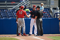 Batavia Muckdogs manager Mike Jacobs (28) shakes hands with Pat Borders (10) during  the lineup exchange with umpires Nolan Earley (left) and Kyle Nichol (right) before a game against the Williamsport Crosscutters on August 19, 2017 at Dwyer Stadium in Batavia, New York.  Batavia defeated Williamsport 11-1 in five innings due to rain.  (Mike Janes/Four Seam Images)