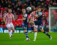 11th January 2020; Bet365 Stadium, Stoke, Staffordshire, England; English Championship Football, Stoke City versus Milwall FC; Jayson Molumby of Millwall under pressure from Nick Powell of Stoke City - Strictly Editorial Use Only. No use with unauthorized audio, video, data, fixture lists, club/league logos or 'live' services. Online in-match use limited to 120 images, no video emulation. No use in betting, games or single club/league/player publications