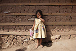 A Triqui Native stands up outside her home in the Yosoyuxi village, in the Triqui region of Oaxaca, November 18, 2005. Teh political violence has been increased by the paramilitary groups like UBISORT in the Triqui region, where they ambushed an humanitarian caravan and killing two people on APril 27, 2010.  Photo by Heriberto Rodriguez