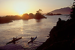 Vancouver Island, Two sea kayakers approaching the Pacific Ocean, Clark Island, Clayoquot Sound, British Columbia, Canada, at sunset, Tofino area,