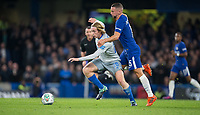 Danny Drinkwater of Chelsea holds back Tom Davies of Everton during the Carabao Cup round of 16 match between Chelsea and Everton at Stamford Bridge, London, England on 25 October 2017. Photo by Andy Rowland.