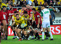 TJ Perenara loses the ball after being knocked by Matt Todd during the Super Rugby match between the Hurricanes and Crusaders at Westpac Stadium in Wellington, New Zealand on Friday, 29 March 2019. Photo: Dave Lintott / lintottphoto.co.nz