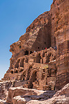 Tourists on the stone arches and stairways below the Urn Tomb, a Royal Tomb in the ruins of the Nabataean city of Petra in the Petra Archeological Park in the Hashemite Kingdom of Jordan.  A UNESCO World Heritage Site.