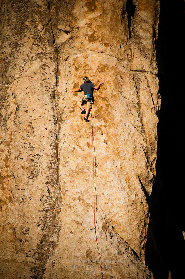 "Rock climbing in the golden light of sunset at The City of Rocks, Idaho.  Route is named ""Delay of Game""  rated 5.8"