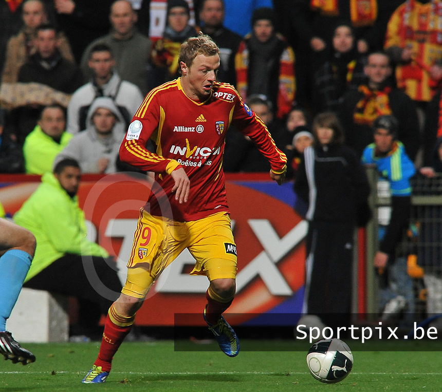 20111202 - LENS , FRANCE : RC Lens'  DAVID POLLET pictured during the soccer match between Racing Club de LENS and TOURS , on the sixteenth matchday in the French Ligue 2 at the Stade Bollaert Delelis stadium , Lens . Friday 2 December 2011 . PHOTO DAVID CATRY