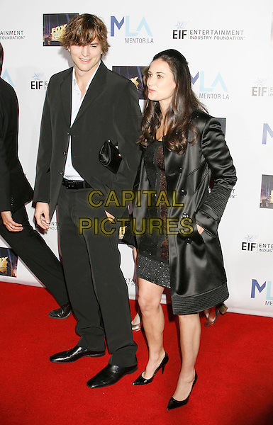 ASHTON KUTCHER & DEMI MOORE.Mentor LA's Promise Gala Honoring Tom Cruise held at 20th Century Fox Studios, Century City, California, USA,.22nd March 2007..full length married couple husband wife black suit dress coat .CAP/ADM/RE.©Russ Elliot/AdMedia/Capital Pictures.