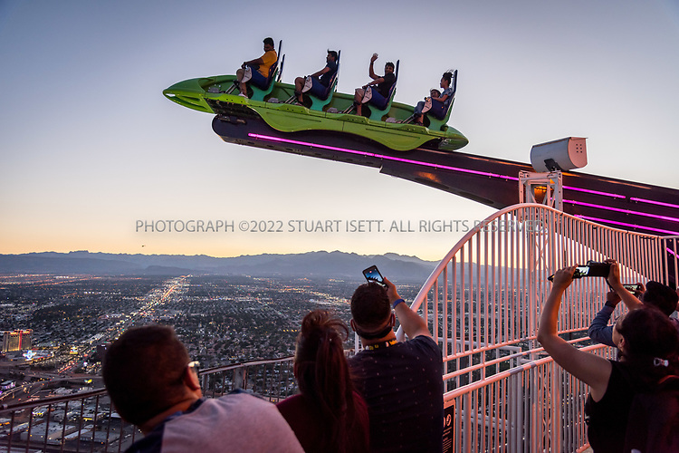 June 3rd, 2017 &mdash; Las Vegas, NEvada<br /> <br /> X-Scream ride is, at a height of approximately 866 feet (264 m), the world's third highest amusement ride, located on top of the Stratosphere Las Vegas. The name of the ride is a play on the word 'Extreme'.<br /> <br /> <br /> Stratosphere Las Vegas (formerly Vegas World) is a hotel, casino, and tower located on Las Vegas Boulevard just north of the Las Vegas Strip in Las Vegas, Nevada, United States.<br /> <br /> The property's signature attraction is the 1,149&nbsp;ft (350.2&nbsp;m) Stratosphere Tower, the tallest freestanding observation tower in the United States,[4] and the second-tallest in the Western Hemisphere, surpassed only by the CN Tower in Toronto, Ontario. It is the tallest tower west of the Mississippi River[5] and also the tallest structure in Las Vegas and in the State of Nevada.[6] The hotel is a separate building with 24 stories, 2,427 rooms and an 80,000&nbsp;sq&nbsp;ft (7,400&nbsp;m2) casino. The Stratosphere is owned and operated by American Casino &amp; Entertainment Properties.<br /> <br /> While the traditional definition of the Strip excludes the Stratosphere, it is often included in travel guides as a Strip attraction. Using this alternate definition, the Stratosphere is the northernmost of the major Strip resorts, and is the only Strip hotel actually located within the City of Las Vegas.<br /> <br /> <br /> Photograph by Stuart Isett. &copy;2017 Stuart Isett. All rights reserved.