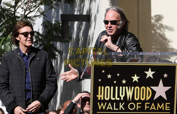 Sir Paul McCartney and Neil Young.Paul McCartney Honored with a Star on the Hollywood Walk of Fame, Hollywood, California, Hollywood, California, USA, .9th February 2012..half length black jacket sunglasses  blue shirt speaking .CAP/ADM/KB.©Kevan Brooks/AdMedia/Capital Pictures.