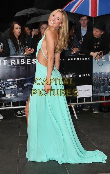 Kimberley Garner.'The Dark Knight Rises' European premiere at Odeon Leicester Square cinema, London, England..18th July 2012.full length blue dress backless back behind rear looking over shoulder side .CAP/ROS.©Steve Ross/Capital Pictures.