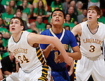 RAPID CITY, S.D. MARCH 20, 2015 -- Jeremiah Hopkins #12 of Little Wound works for rebounding position between Landon Hoellein #34 and Sam Reynen #3 of Aberdeen Roncalli during their semi-final game at the 2015 South Dakota State A Boys Basketball Tournament at the Don Barnett Arena in Rapid City, S.D.  (Photo by Dick Carlson/Inertia)